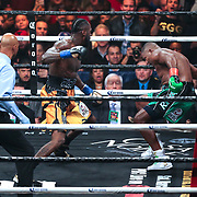 Deontay Wilder knocks Luis Ortiz into the ropes during the WBC Heavyweight Championship boxing match at Barclays Center on Saturday, March 3, 2018 in Brooklyn, New York. Wilder would win the bout by knockout in the tenth round to retain the title and move to 40-0. (Alex Menendez via AP)