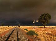 Storm over borehole pump, Namibia