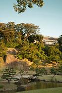 An arched bridge and pond in the Gyokusen'in maru Garden in Kanazawa, Ishikawa, Japan