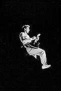 Pete Townshend of The Who singing and playing guitar