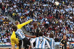 03.07.2010, CAPE TOWN, SOUTH AFRICA, Goalkeeper Manuel Neuer ( FC Schalke 04 #01 )  of Germany punches clear of Martin Demichelis of Argentina attempted header Match 59 of the 2010 FIFA World Cup, Argentina vs Germany held at the Cape Town Stadium EXPA Pictures © 2010, PhotoCredit: EXPA/ nph/  Kokenge