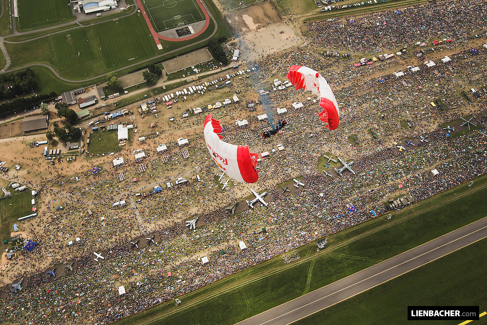 Georg Lettner and David Hasenschwandtner perform a downplane with their canopies over the audience of the Airpower 2013, Zeltweg, Austria, June 29th 2013<br /> <br /> There were a total of 300.000 people watching the show