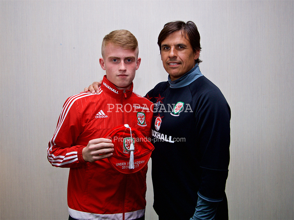 CARDIFF, WALES - Tuesday, June 6, 2017: Wales' Daniel Roberts receives his cap from senior team manager Chris Coleman during a presentation at the Vale Resort. (Pic by David Rawcliffe/Propaganda)