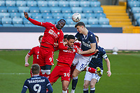 Football - 2020 /2021 Emirates FA Cup - Fourth Round : Millwall vs. Bristol City <br />  -  The Den<br /> <br /> Jake Cooper (Millwall FC) and Famara Diedhiou (Bristol City) compete for the high ball as the corner is swung in<br /> <br /> COLORSPORT/DANIEL BEARHAM