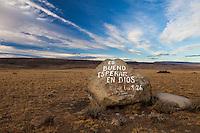 """PIEDRA EN LA ESTEPA CON ESCRITO """"ES BUENO ESPERAR EN DIOS"""", EL CALAFATE,  PROVINCIA DE SANTA CRUZ, PATAGONIA, ARGENTINA (PHOTO BY © MARCO GUOLI - ALL RIGHTS RESERVED. CONTACT THE AUTHOR FOR ANY KIND OF IMAGE REPRODUCTION)"""