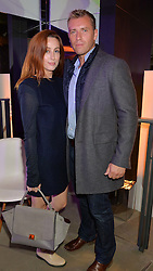 SIOBHAN DONAGHY and her husband CHRIS McCOY at a party to celebrate the reopening of the Lacoste Premium Store at 233 Regent Street, London on 28th May 2014.