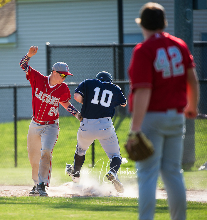 Laconia's Graham Nyhan makes the out on White Mountain's Derrick McCann during Friday afternoon varsity baseball.  (Karen Bobotas/for the Laconia Daily Sun)