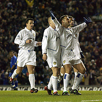 Photo. Jed Wee<br />Leeds United v Gillingham, AXA FA Cup Replay, Elland Road, Leeds. 04/02/2003.<br />Leeds' Mark Viduka spreads his arms in celebration with his team mates after scoring.