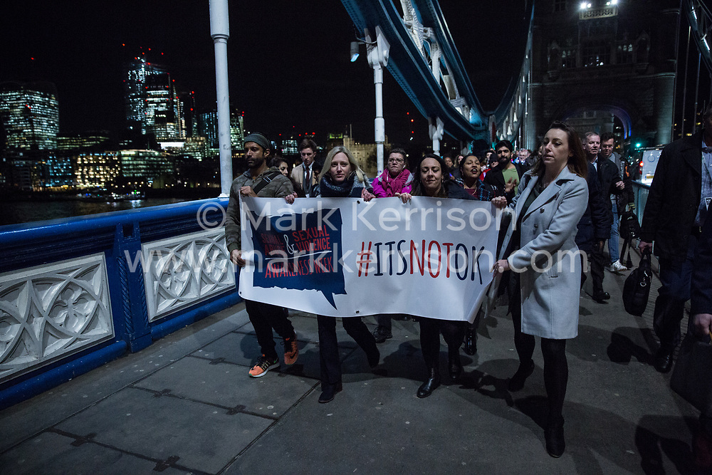 London, UK. 6th February, 2019. Actor, musician, director, producer and UN HeForShe ambassador Farhan Akhtar (l) joins around fifty women taking part in the #ItsNotOK Light Up The Night march over Tower Bridge for National Sexual Abuse & Sexual Violence Awareness Week 2019. Farhan, the first male UN HeForShe Ambassador, recently launched the campaigning organisation Men Against Rape & Discrimination (MARD) in India.