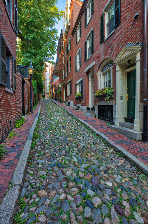 Historic Boston photography image of old colonial brick row houses along romantic Acorn Street on a beautiful late afternoon. Acorn Street is located near Louisburg Square, the most prestigious address in Beacon Hill. Street lanterns provide a warm light in Beacon Hill. Acorn Street is often noted as the most frequently photographed street in the USA. It is a narrow lane paved with cobblestones that was home to coachmen employed by families in Mt. Vernon and Chestnut Street mansions.<br /> <br /> Boston photography images of historic Acorn Street in Beacon Hill are available as museum quality photography prints, canvas prints, acrylic prints or metal prints. Prints may be framed and matted to the individual liking and wall decoration needs: <br /> <br /> https://juergen-roth.pixels.com/featured/boston-beacon-hill-acorn-street-juergen-roth.html<br /> <br /> Good light and happy photo making!<br /> <br /> Juergen<br /> Prints: http://www.rothgalleries.com<br /> Photo Blog: http://whereintheworldisjuergen.blogspot.com<br /> Twitter: @NatureFineArt<br /> Instagram: https://www.instagram.com/rothgalleries<br /> Facebook: https://www.facebook.com/naturefineart