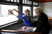 """Sherry Greene, left, tapes a """"For Sale"""" sign in the window of the Polka Dot Restaurant in White River Junction, Vt. for her mother Mary Shatney, the restaurant's owner, Thursday, April 30, 2015. Shatney bought the Polka Dot in the early 1980's, and Greene waitressed there in the 1970's.  (Valley News - James M. Patterson)<br /> Copyright © Valley News. May not be reprinted or used online without permission. Send requests to permission@vnews.com."""