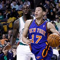 04 March 2012: New York Knicks point guard Jeremy Lin (17) drives past Boston Celtics power forward Brandon Bass (30) during the Boston Celtics 115-111 (OT) victory over the New York Knicks at the TD Garden, Boston, Massachusetts, USA.