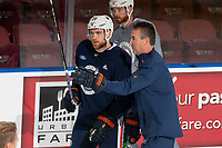 KELOWNA, BC - SEPTEMBER 23: Leon Draisaitl #29 of the Edmonton Oilers speaks to Associate Coach Jim Playfair on the ice during practice at Prospera Place on September 23, 2019 in Kelowna, Canada. (Photo by Marissa Baecker/Shoot the Breeze)