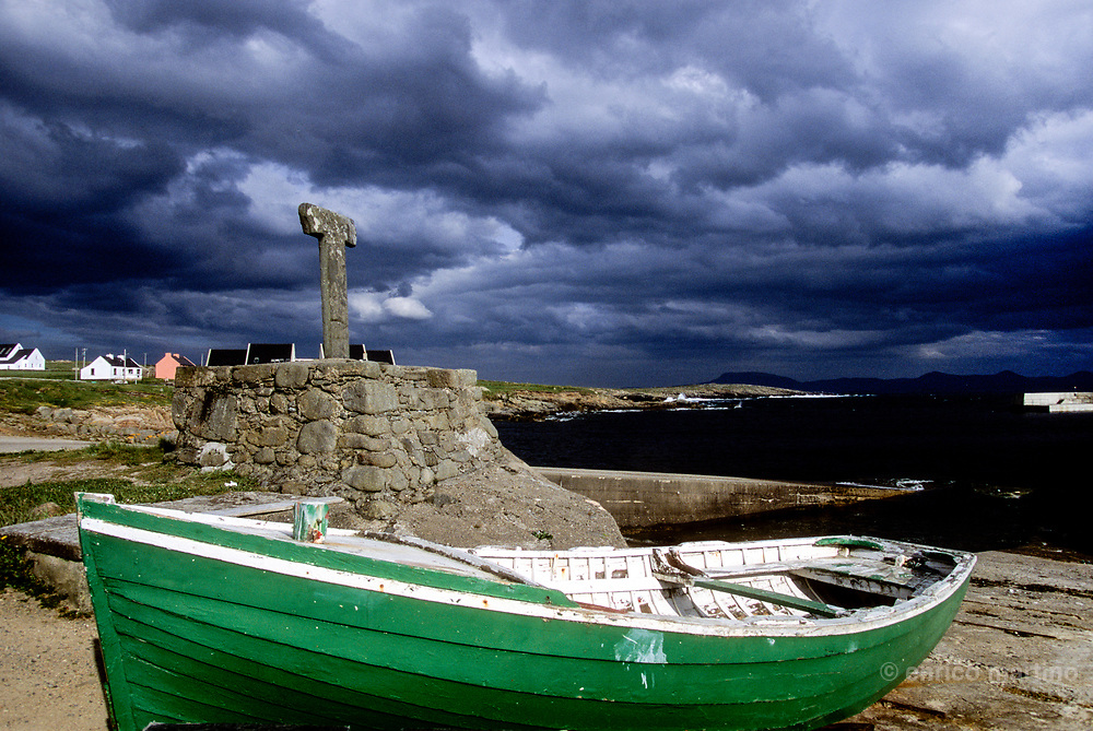 Tory Island harbour. The Tau Cross, one of the two survived in all Ireland, is what remains of the monastery founded by St Columba.