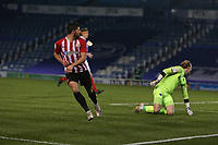 Football - 2020 / 2021 Sky Bet League One - Portsmouth vs. Sunderland - Fratton Park<br /> <br /> Jordan Jones of Sunderland watches on as his dinked shot goes in to score Sunderlands second goal. You can just see the league one badge has come loose on his shirt sleeve during the League One fixture at Fratton Park  <br /> <br /> COLORSPORT/SHAUN BOGGUST