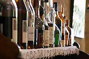 Restaurant Le Clos du Roy. Brandy and cognac bottles. Saint Emilion, Bordeaux, France