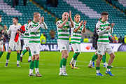 Celtic Captain Scott Brown (C) (#8) with team mates Leigh Griffiths (#9) & Mikey Johnston (#19) applauds the fans during the Europa League match between Celtic and Rennes at Celtic Park, Glasgow, Scotland on 28 November 2019.
