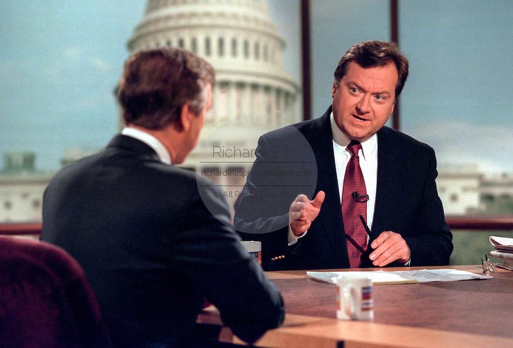 Host Tim Russert talks with Defense Secretary William Cohen August 23, 1998 during NBC's Meet the Press in Washington, DC.