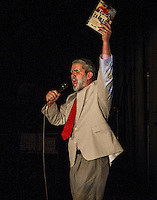 """Mystery Guest Ron Kaiser dressed at Principal McCollum performs """"Teach Like a Champion"""" to the tune of Queen's We Are the Champions during Laconia's Got Talent on Thursday evening to benefit the Got Lunch program.   (Karen Bobotas/for the Laconia Daily Sun)"""