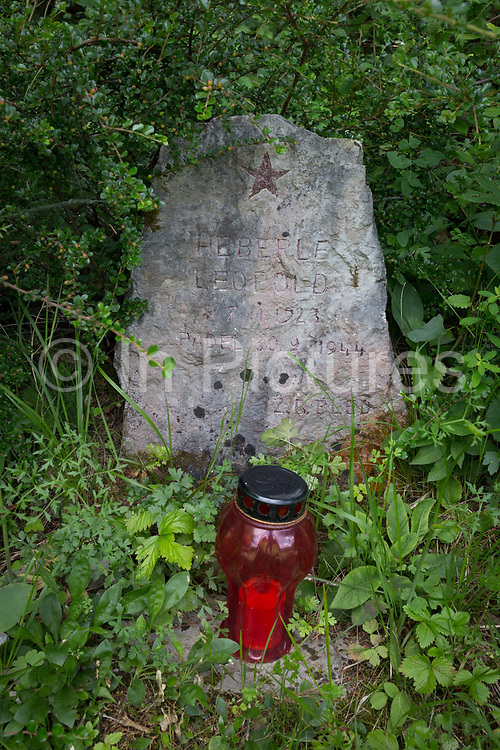 The grave of a Partisan fighter, killed during WW2 in 1944, on 18th June 2018, in Kupljenik, Slovenia.