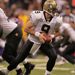 2008 October, 06: New Orleans Saints quarterback Drew Brees (9) looks to handoff during the first half of a week five regular season game between the Minnesota Vikings and the New Orleans Saints for Monday Night Football at the Louisiana Superdome in New Orleans, LA.