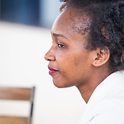 INDIVIDUAL(S) PHOTOGRAPHED: Diana Adkiny. LOCATION: Shortlist Office, Daykio Plaza, Ngong Road, Nairobi, Kenya. CAPTION: Diana sits down for a meeting with a colleague on a Monday morning at Shortlist's office in Nairobi.