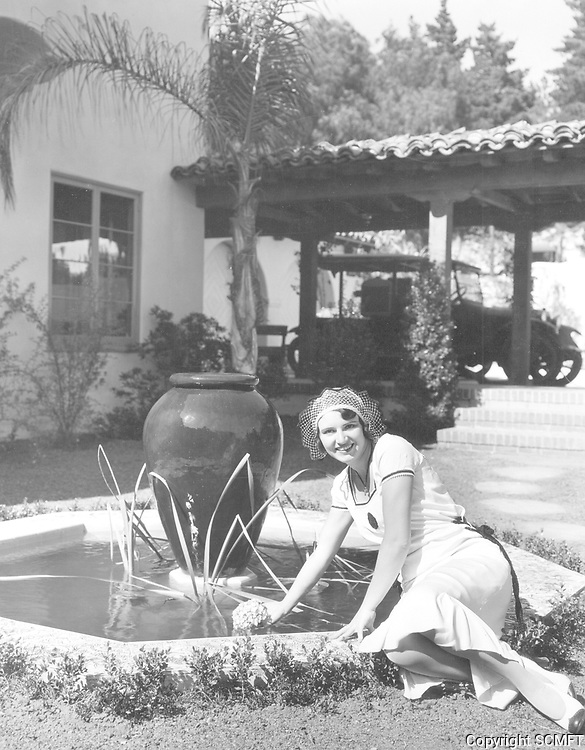Circa 1930 Miss Betty Boyd by a fountain at 1900 Outpost Dr. in the Outpost Estates