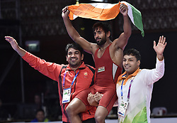 JAKARTA, Aug. 19, 2018  Bajrang Bajrang (C) of India celebrates after winning gold medal of Men's Wrestling Freestyle 65 kg Final against Takatani Daichi of Japan in the 18th Asian Games at Jakarta, Indonesia, Aug. 19, 2018. (Credit Image: © Li He/Xinhua via ZUMA Wire)