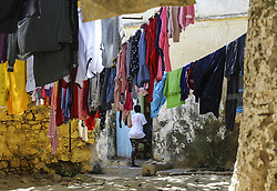 DAKAR, SENEGAL - FEBRUARY 28: A Senegalese woman hangs out laundry at the Goree Island known as 'Island of Shame' due to its bad reputation in consequence of being a center of Atlantic slave trade between 15th to 19th century, in Dakar, Senegal on February 28, 2018. Island of Shame is now used as a museum to show colonialism and slavery activities of today's 'civilized' countries such as Portugal, Netherlands, England and France.<br /> <br /> <br /> <br /> <br /> <br /> <br />  Halil Sagirkaya / Anadolu Agency    BRAA20180308_108 Dakar Sénégal