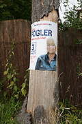 """A landscape of an election poster for the Polish political candidate Marta Fogler of the Citizens' Coalition, on a residential street's tree, on 16th September 2019, in Zakopane, Malopolska, Poland. Poland's parliamentary elections will be held on 13 October 2019 when all 460 members of the Sejm and 100 senators will be elected. The Sejm of the Republic of Poland is the lower house of the Polish parliament. It consists of 460 deputies elected by universal ballot and is presided over by a speaker called the """"Marshal of the Sejm of the Republic of Poland"""""""