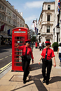 Bond Street, central London. Information officers for the area in their red uniforms. T assist people int he area.