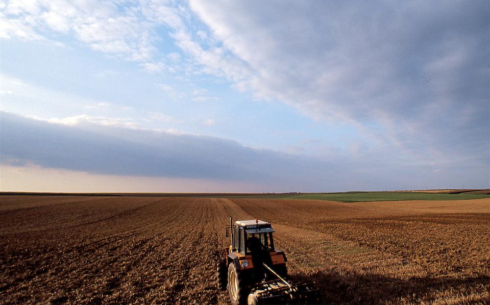 Plowing in Nord-Pas-de Calais Area, countryside of France. Paysage agricole du Nord-Pas-de-Calais, France.
