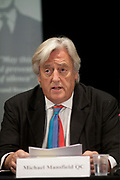 Russell Tribunal press conference at Amnesty International. Michael Mansfield QC reading the findings of the tribunal based on 2 days of witness statements, member of the jury.