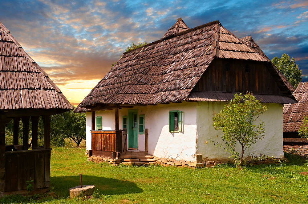 19th century Traditional stone & thatch farm house. Casa Maghira, Campulung La Tisa, Tissa Valley, Maramures, Northern Transylvania .<br /> <br /> Visit our ROMANIA HISTORIC PLACXES PHOTO COLLECTIONS for more photos to download or buy as wall art prints https://funkystock.photoshelter.com/gallery-collection/Pictures-Images-of-Romania-Photos-of-Romanian-Historic-Landmark-Sites/C00001TITiQwAdS8