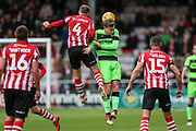 Lincoln City Michael O'Connor(4) and Forest Green Rovers Dayle Grubb(8) jump for the ball during the EFL Sky Bet League 2 match between Lincoln City and Forest Green Rovers at Sincil Bank, Lincoln, United Kingdom on 3 November 2018.