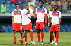 England's Ashley Young (second left) sprays insect repellent as Trent Alexander-Arnold (left), Danny Welbeck and Raheem Sterling (right) looks on before the FIFA World Cup Group G match at The Volgograd Arena, Volgograd.