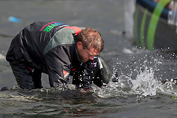 Kiel - Germany, 28th of August 2009. iShares cup. First day of racing...The first racing day consisting of 8 races. Picture shows Ecover just after they capsized between race 3 and 4.  Will Howden working underwater on the rigging of Ecover.