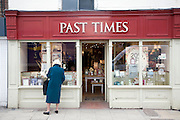 Past Times shop, woman looking in window, Colchester, Essex