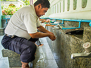 10 APRIL 2015 - BANGKOK, THAILAND: A man performs ablutions before Friday prayers at Masjid Ton Son in Bangkok. (Masjid is the Thai word for Mosque.) A Pew Research Center study recently released identified Islam as the fastest growing religion in the world. Masjid Ton Son was the first mosque in Bangkok, founded in 1688 during the reign of King Narai, of the Ayutthaya era. Muslims are about 5 percent of Thailand, but make up a bigger proportion of Bangkok. Thailand's deep south provinces are Muslim majority.    PHOTO BY JACK KURTZ