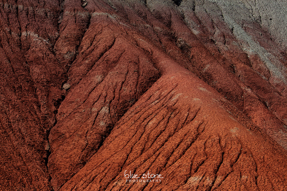 A natural erosion pattern in dark red, rust and slate grey rock.<br /> <br /> Wall art is available in metal, canvas, float wrap and standout. Art prints are available in lustre, glossy, matte and metallic finishes.