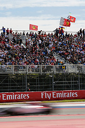 October 21, 2018 - Austin, TX, U.S. - AUSTIN, TX - OCTOBER 21: Car races past turn 4 grandstand as flags wave during the F1 United States Grand Prix on October 21, 2018, at Circuit of the Americas in Austin, TX. (Photo by John Crouch/Icon Sportswire) (Credit Image: © John Crouch/Icon SMI via ZUMA Press)