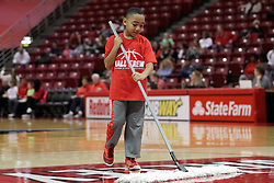 21 December 2015: ball crew broom boy. Illinois State University Women's Basketball team hosted The Cougars of Chicago State at Redbird Arena in Normal Illinois.