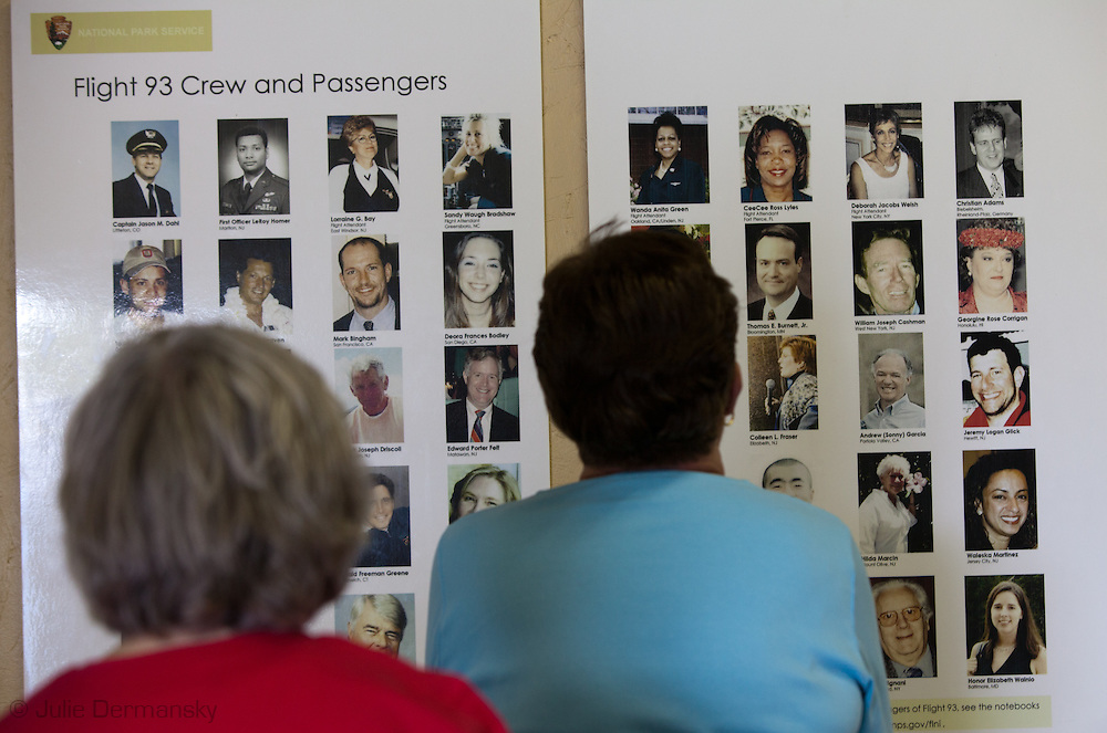 People looking at a plaque listing all the dead at Flight 93 National Memorial site's temporary memorial  that overlooks the field where the flight crashed in Shanksville Pennsylvania. The temporary site will close on Sept. 9th at 4 P.M. and on Sept. 10 the official memorial will open in time for the 10th anniversary of 9/11