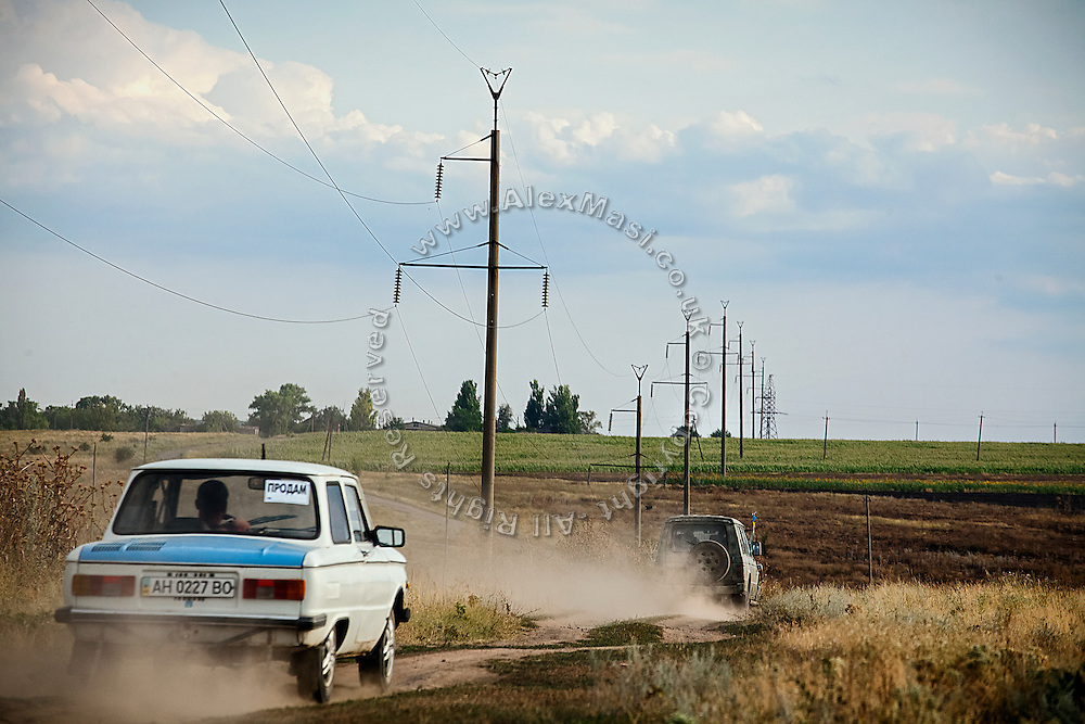 The 4x4 vehicle used by volunteer drone pilots during their trips to the frontline, is travelling back from the field where they test their quadcopters, back to Mariupol, southeast Ukraine.
