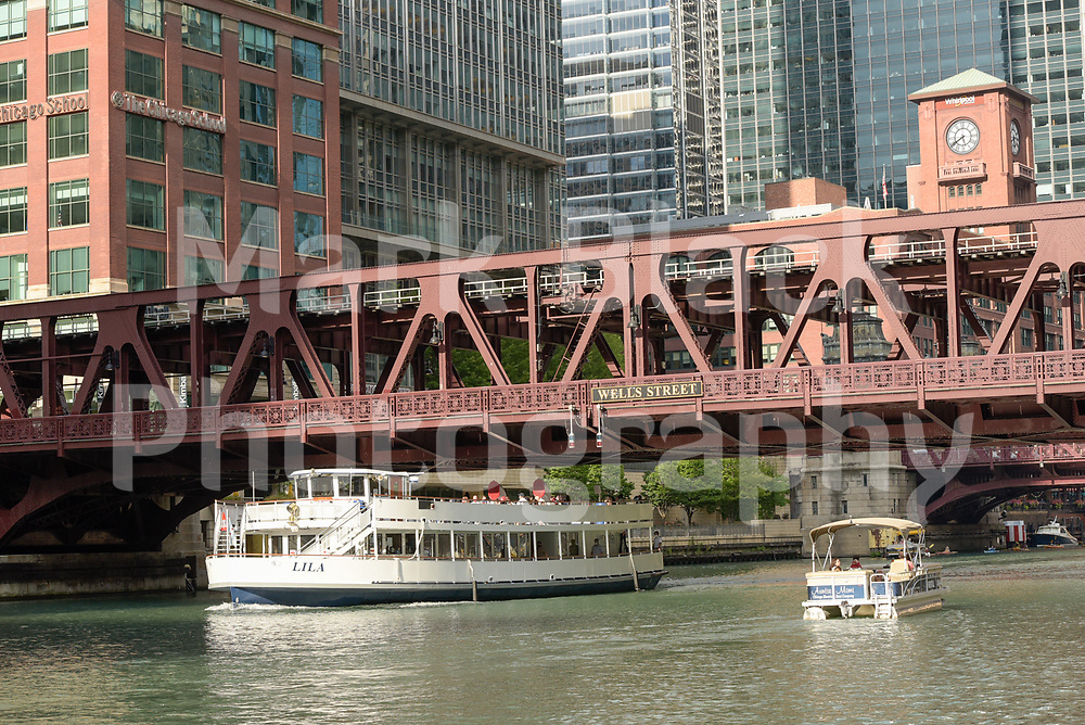 CTA L train on the Wells Street bridge over the Chicago River in Chicago, Illinois. Photo by Mark Black