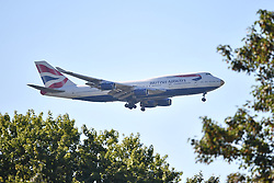 """© Licensed to London News Pictures. 23/08/2016. London, UK. Members of the Great Britain Olympic team land at London Heathrow Airport on British Airways flight BA2016, decorated with a gold nose and the name """"victoRIOus"""" on its livery. Team GB finished second in the medals table with 67 medals, beating their total of 65 at London 202.  Photo credit: Ben Cawthra/LNP"""