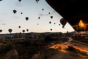 Hot-air balloons in Cappadocia. Everyday numerous hot-air balloons take flight early in the morning to assist to the sunrise.