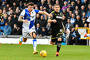 Tom Broadbent (16) of Bristol Rovers battles for possession with Cody McDonald (10) of AFC Wimbledon during the EFL Sky Bet League 1 match between Bristol Rovers and AFC Wimbledon at the Memorial Stadium, Bristol, England on 18 November 2017. Photo by Graham Hunt.