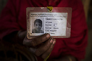 """Kulsum Bahar, 27, holds the Myanmar national's registration card of her daughter, Jannatara, 8, who has gone missing, without a trace, 14 months ago on her way to a learning centre from her home in the Balukhali refugee camp, Cox's Bazar, Bangladesh, December 2, 2019. Kulsum believes her daughter has been abducted by child traffickers. """"If only I could know that she is alive and well. I would hold her tight. I would tell that I love her"""", she explains, holding back her tears. """"I feel that if she is indeed alive, she is very far away from here"""". There has been an increase in children being reported missing or confirmed abducted within the Rohingya community inside the camps. Human trafficking can be summarized as the recruitment, transportation or receipt of people through deception or coercion for the purpose of exploitation including prostitution, sexual exploitation, forced labor or removal of organs. Women and girls are recruited for labor exploitation as domestic servants, restaurant and hotel workers, farm employees and or supermarket and factory employees. They are also recruited for sexual exploitation – prostitution, forced marriages. For children, there are reports that they are used in illicit activities – drug trafficking, particularly yaba drugs. However, it is difficult to confirm the true scale of trafficking because cases may not be reported and the verification of cases takes a long time, particularly if there is no trace of the person who is reported to have been trafficked. It is known that different types of trafficking and migration take place in Cox's Bazar. It is likely that the scale of trafficking is higher than official records suggest. Both Bangladeshis and refugee communities are reportedly involved in trafficking. Older refugees who arrived prior to the 2017 influx are reported to be well established in Bangladesh and often use their established contacts to recruit newly arrived refugees.  Agents reportedly exist both with"""