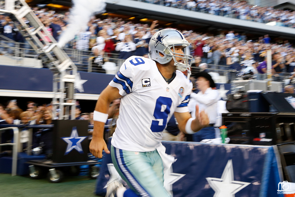 Dallas Cowboys quarterback Tony Romo (9) run onto the field during the opening ceremony against the Pittsburgh Steelers at Cowboys Stadium in Arlington, Texas, on December 16, 2012.  (Stan Olszewski/The Dallas Morning News)